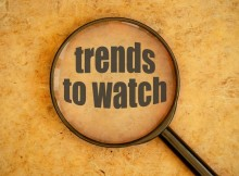 Magnifying glass over trends to watch text